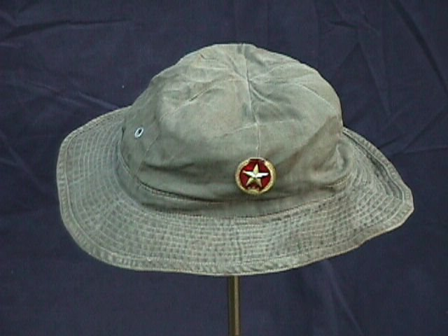 b7a5ab48aad Boonie hat with Peoples Army of Vietnam (PAVN) badge pinned to front. These  caps were very similar to the U.S. couterpart but were often constructed  with a ...