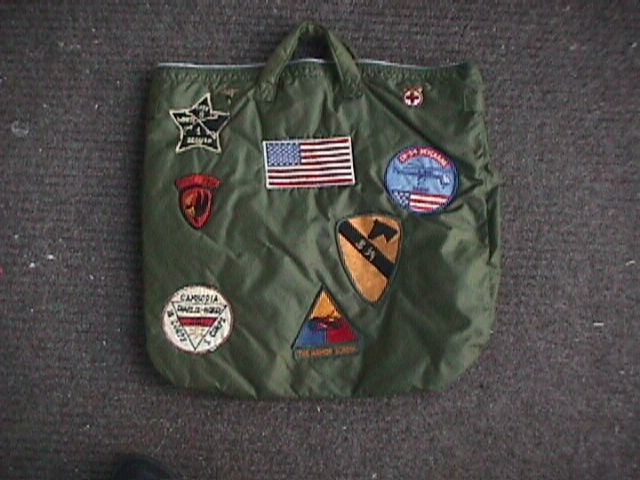 Flight helmet bag adorned with patches for flight school and combat units.  The practice was not uncommon but few rated so many different units fb063387f840d